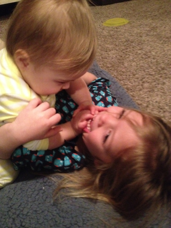 already wrestling her big sister