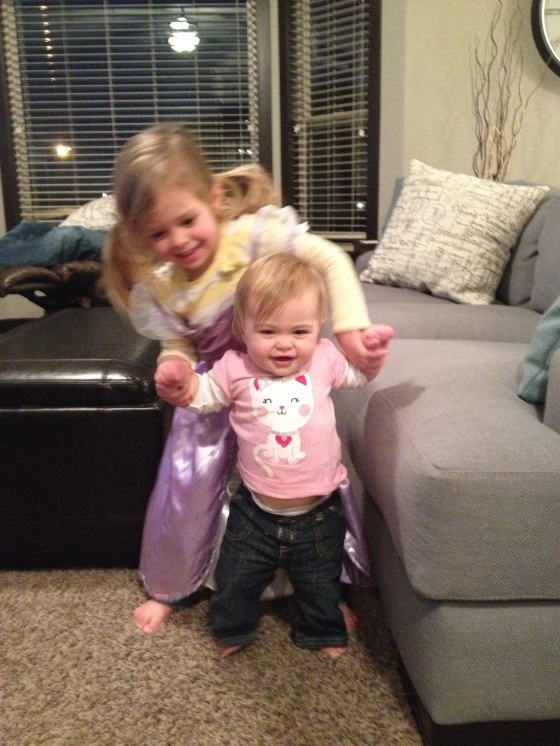big sister helping Kendall walk