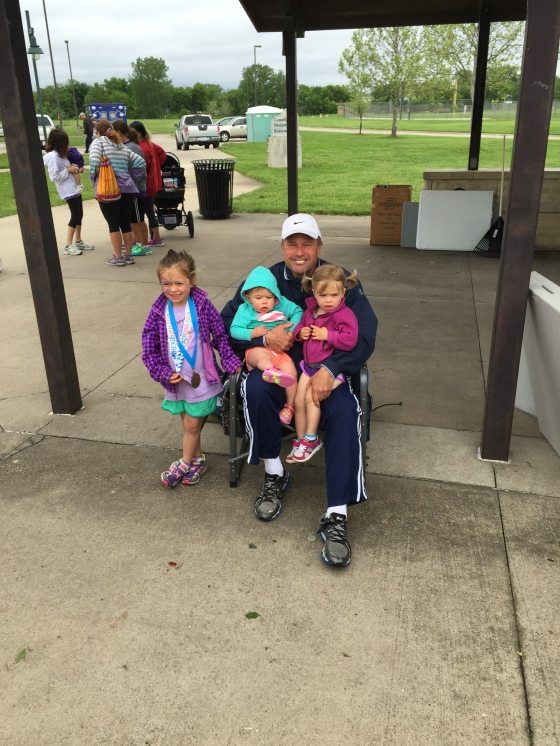 Grandpa with his girls at Head for the Cure